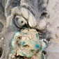 A poultice partially covers a gargoyle to draw out copper staining and salt (Click to view enlarged image.)
