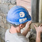 A construction worker rehabilitates a window arch, Southeast Tower, West Block (Click to view enlarged image.)