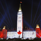 Northern Lights sound and light show: The Canadian Flag is projected onto Parliament Hill's Centre Block. Credit: Canadian Heritage (Click to view enlarged image.)