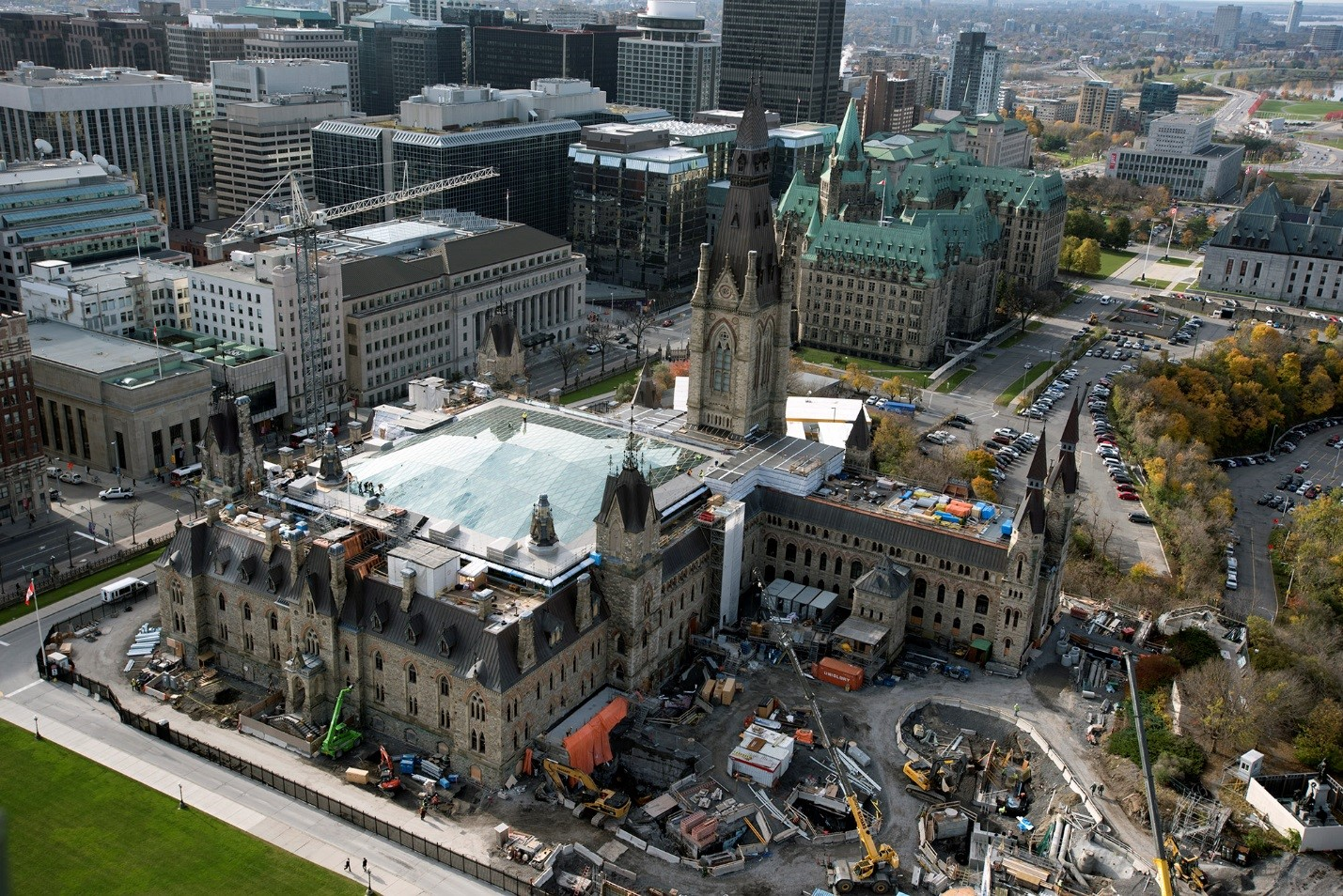 View enlarged image of an aerial photo of a building surrounded by construction vehicles and equipment.