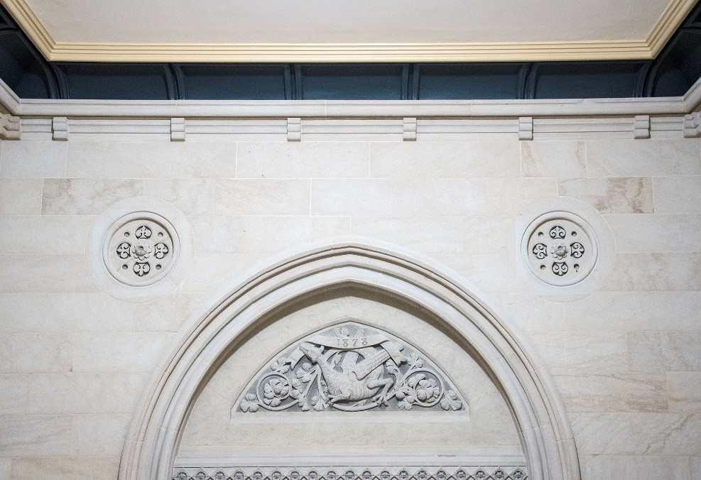 View enlarged image of stone carvings on the interior wall of a building.