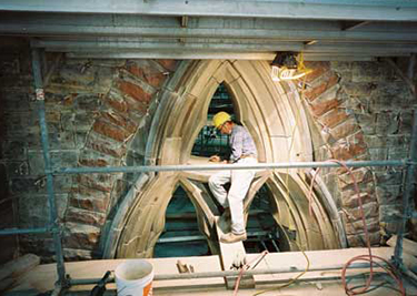 Restoring stone at Reading Room window, February 3, 2004. (Photo: Roy Grogan.)
