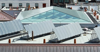 View enlarged image of the light well and solar panels on the roof of the Wellington Building